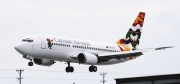 A Cayman Airways plane returns from Costa Rica branded with Coat of Arms. (Cayman Net News)